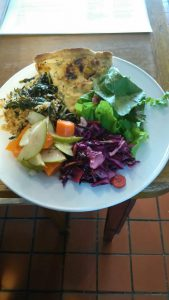 Salad plate with quiche.
